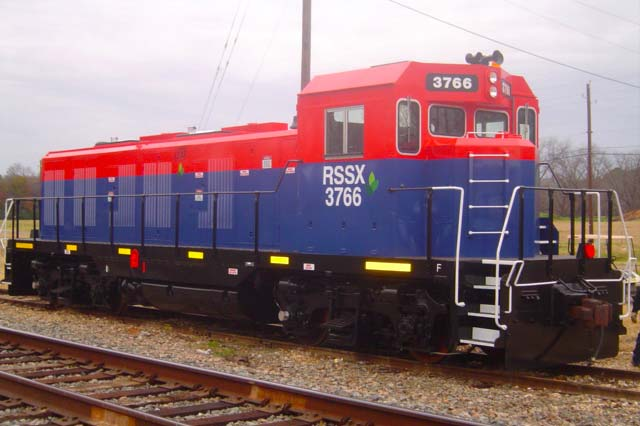 Red and blue locomotive manufactured by Railserve